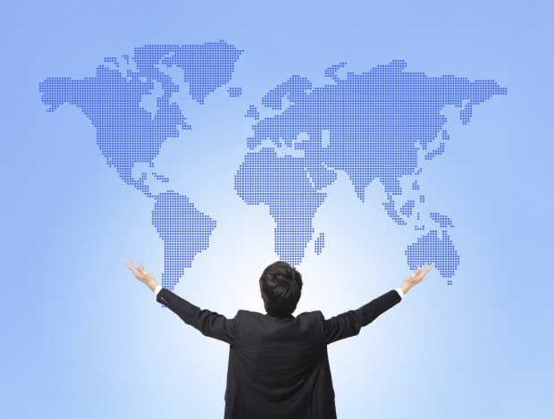 Business man hug global map