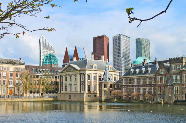 Binnenhof Palace - Dutch Parlament against the backdrop of moder