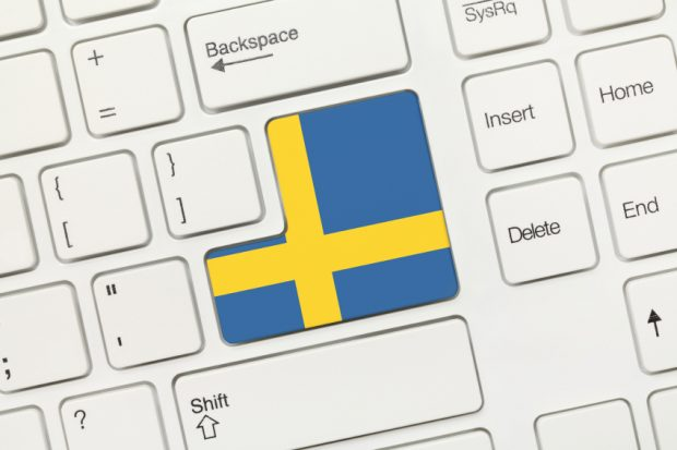 Close-up view on white conceptual keyboard - Sweden (key with flag)
