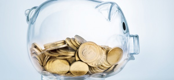 A see through piggy bank with money coins