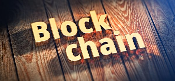 "The words ""Block chain"" is lined with gold letters on wooden planks. 3D illustration image"