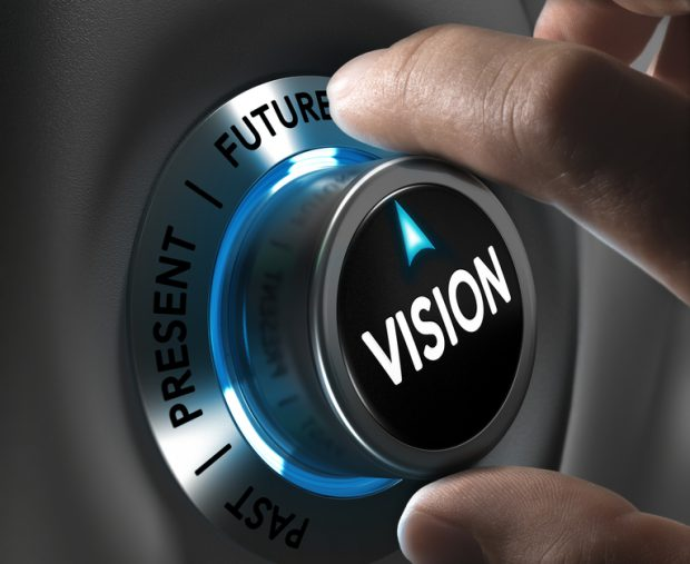 Button vision pointing the future with blur effect plus blue and grey tones. Conceptual image for illustration of company or business anticipation or strategy.