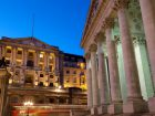 Bus passing the exterior of the Bank of England and the Royal Exchange in the City of London, UK, Europe