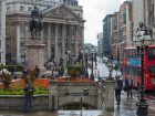 London, UK - September 15, 2015: Bank of England square view with tube entrance at the raining day. People walking pass the square