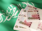 Saudi Riyal banknote bundles on textile textured Saudi Arabian flag. 3d rendered illustration.