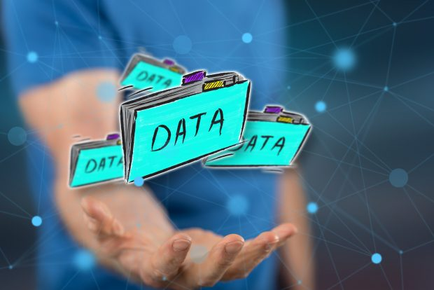 Data concept above the hand of a man in background